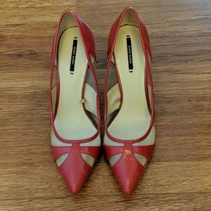 Zara clear and red heels.